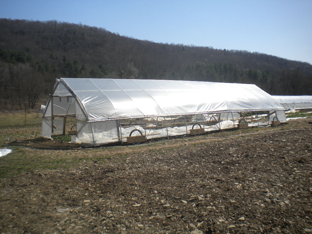 Low-cost mobile hoop house