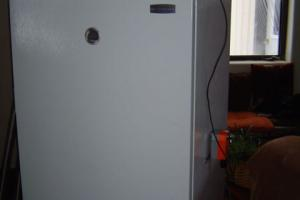 Freezer exterior with control box on top and actuator on right side